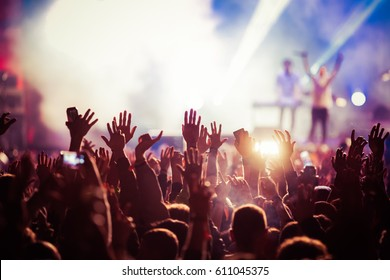 crowd at concert - summer music festival - Shutterstock ID 611045375