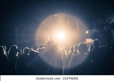 crowd at a concert in a vintage light. grain added