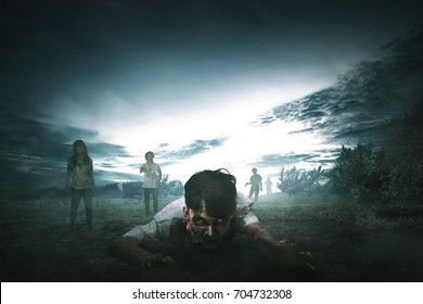 Crowd of creepy asian zombies with angry face walking around on the spooky countryside