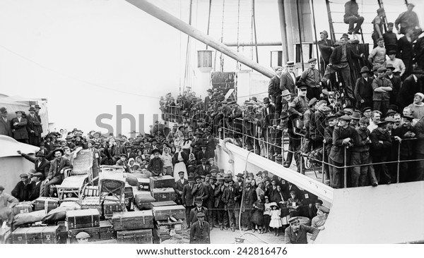 A crowd of European immigrants and their luggage on the THE IMPERATOR, then the world's largest Ocean Liner, arriving in New York Harbor on June 19, 1913 with over 4,000 passengers. June 1913.