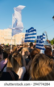 a crowd holding Greek waving flags Protesting for NO in Athens demonstration demonstration against austerity measures,