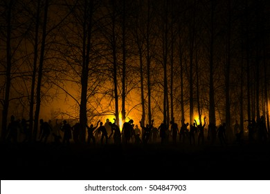 crowd of hungry zombies in the woods. Silhouettes of scary zombies walking in the forest at night. yellow Acid variant
