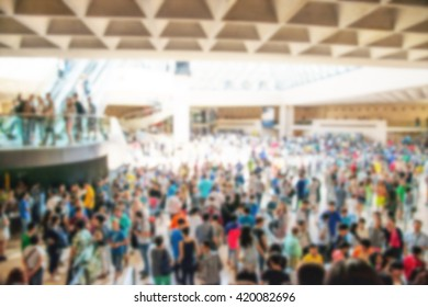 crowd inside a structure with unrecognizable people with blur effect