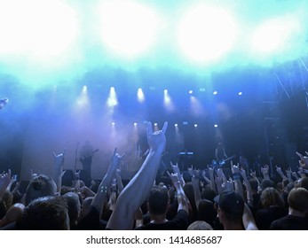 crowd making metal gesture after rockband played at rock festival