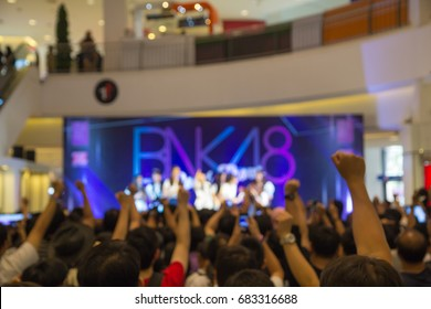 Crowd at mall concert BNK48 Thailand - July 16th, 2017 Crowd at mall concert and blurred stage lights
