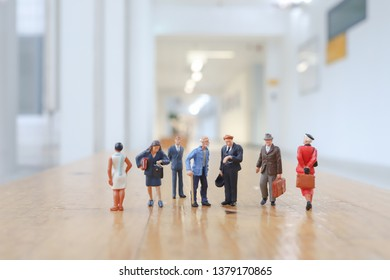 a Crowd of mini figures are conference hall