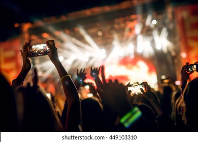 Crowd at music festival. Some of them recording Dj with their smart phones.