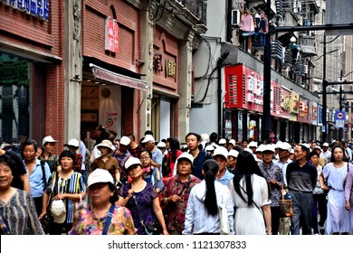 Crowd on vibrant streets of Shanghai. Shanghai - one of the most visited places in the world, famous business, cultural, and tourist attraction in China. Photo taken 2018-05-27.