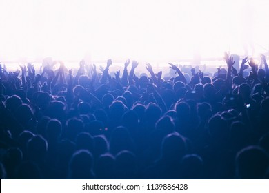 Crowd of people at the bright concert show with the hand raised up, horizontal isolated background