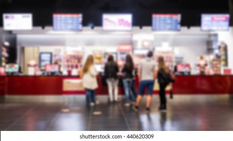 Crowd of People Buying Ticket  in shopping mall. Blur Image