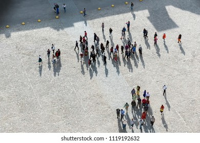 Crowd of people in center of town, top view. Tourists traveling.