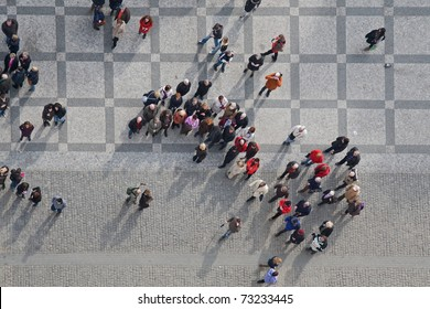 crowd of people in center of town, top view