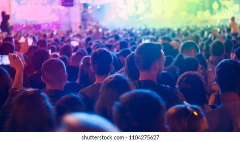 crowd of people at concert or show, defocused background