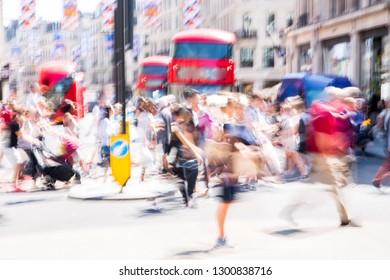 Crowd of people crossing the road. London, UK