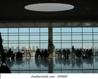 Crowd of people dining at the airport lounge