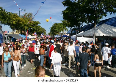 "Crowd of people gathered at the ""Calle Ocho"" Carnival in Miami Florida USA."