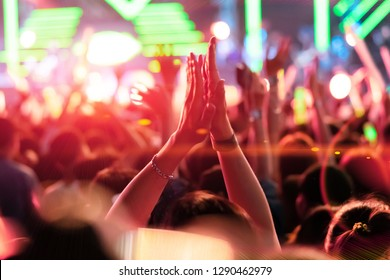 Crowd of People Hands Clap Concert Stage Lights, Color of the year 2019.