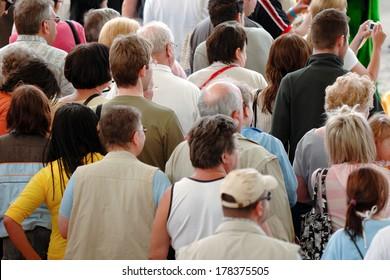 Crowd of people leaving stadium