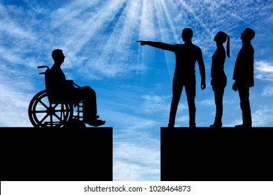 Crowd of people makes it clear to the disabled person in the wheelchair that he must walk away and the gap between them. The concept of Discrimination of people with disabilities in society