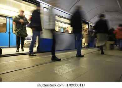 crowd of people metro in motion blurred, abstract background urban traffic people