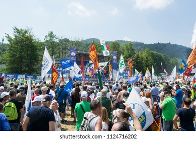 "A crowd of people of militants at the annual celebration of the political party ""Lega"", with a lot of flags, exultations and applause. Italy-Pontida 01 July 2018"