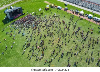 Crowd of people near the stage at the festival, top view