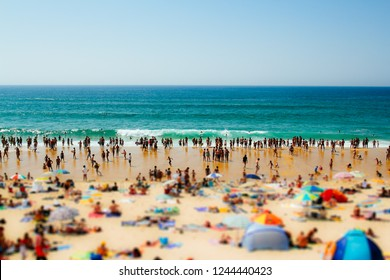 Crowd of people on the overcrowded beach in the summer