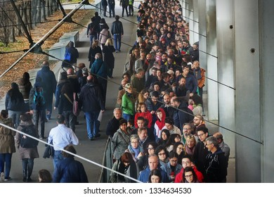 Crowd of people in the queue from above. Milan, Italy - March 2019
