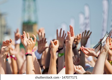 crowd of people raised their hands