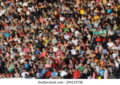 Crowd of people at a soccer match - blurred image