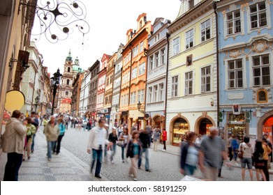 Crowd of people in streets of Prague.