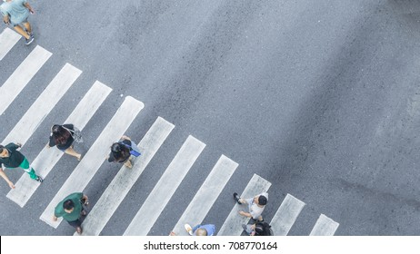Crowd of people walk on street pedestrian crossroad in the city street ,from top view ,bird eye view.