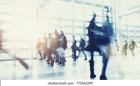 Crowd of people walking in a modern environment