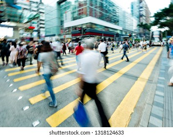 Crowd of people walking on busy hong kong street.