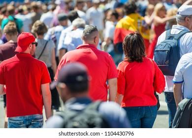 Crowd of people walking on city street