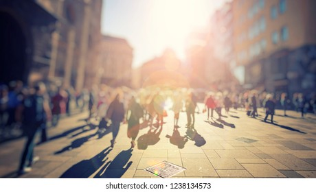 crowd of people walking on city streets