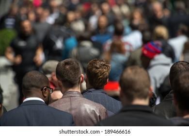 Crowd of people walking on New York City street sidewalk