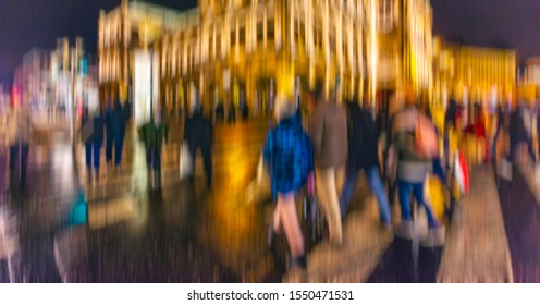 crowd of people walking on night streets in the city