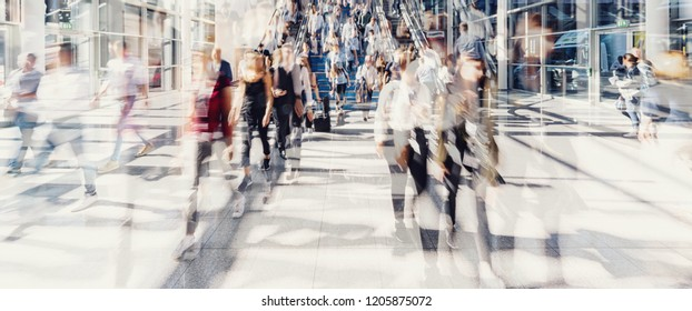 Crowd of people walking on a street in New York City