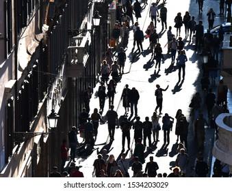 Crowd of people walking on street sidewalk. Silhouette people