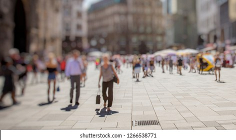 crowd of people walking on summer city streets
