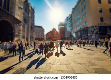 crowd of people walking on sunny streets
