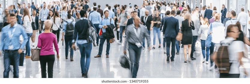 Crowd of people walking at trade fair