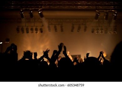 Crowd at popular music concert. Blurred image.