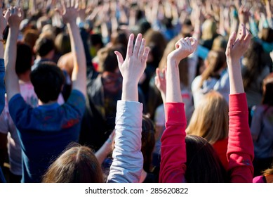 The crowd with raised hands