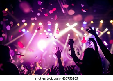 Crowd raising their hands and enjoying great festival party.