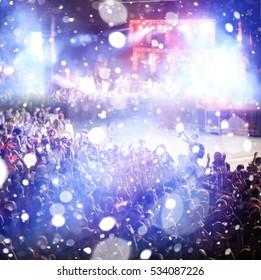 crowd at a rock concert spotlight background blur