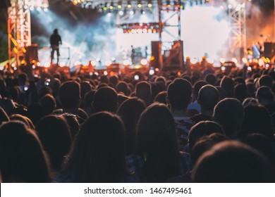 Crowd of spectators having fun at a concert.
