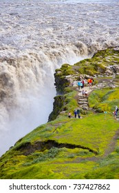 Crowd of tourists watching powerful river flowing over Dettifoss waterfall, Vatnajokull National Park, Iceland, July 2017