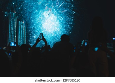Crowd watching fireworks at new year.